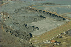Coal ash slurry left behind in a containment pond near the Kingston Fossil Plant is shown Dec. 29, 2008 in Harriman, Tenn., after the dyke at left broke one week before, unleashing a billion gallon flood of toxic sludge into the Emory River.