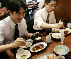 Japanese businessmen enjoy a whale meat lunch in Tokyo. The Japanese whaling fleet is now on its annual hunt in the Antarctic, keeping specialty restaurants alive but drawing blunt public criticism.
