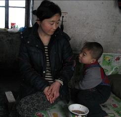 Yang Cunying and son Gao Cunya, 4, live in a one-room apartment near Jilin, China.