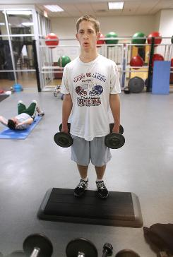 Sam Silverman, 16, works out at the YMCA gym in Westborough, Mass., on Wednesday. Silverman, co-captain of his high school football team and a vegetarian, says he's pleased with his health.
