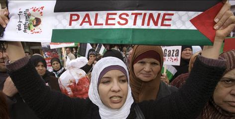 Palestinian women join in a peaceful protest in Ramallah on Sunday against Israel?s offensive in Gaza.