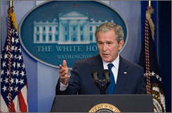 President Bush defended the legacy of his presidency before reporters in Washington on Monday.