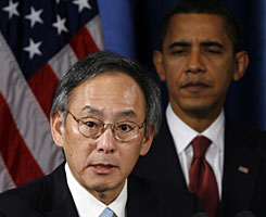 Barack Obama looks on as his choice for Energy secretary, Steven Chu, speaks Dec. 15 in Chicago.