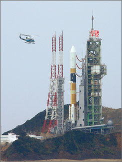 Japan has its first commercial order to launch a satellite on a rocket. Here, a chopper flies over the launching pad of a Japanese spy satellite at Tanegashima Space Center in February 2007.