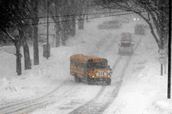 A school bus maneuvers a snowy street in Bismarck, N.D., on Tuesday. Almost 5 feet of snow has fallen there this winter.
