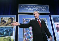 President Bush takes the stage to address the National Conference on Faith-Based and Community Initiatives in Washington, March 9, 2006.