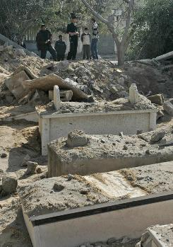 An Israeli warplane bombed a crammed cemetery in Gaza City on Jan.14 sending body parts flying onto neighboring houses and knocking a large hole into the graveyard.