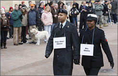 Army Sgt. Derrick Brooks, left, standing in for President-elect Barack Obama, and Navy Yeoman 1st Class LaSean McCray, standing in for Michelle Obama, walk the inauguration parade route on Pennsylvania Avenue.