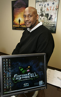 Asante Bradford, who is the digital entertainment liaison with Georgia's Department of Economic Development, poses in his Atlanta office Wednesday in Atlanta.  After Barack Obama's historic presidential win, Bradford gave his bosses notice that he would not be at his desk on Jan. 20.