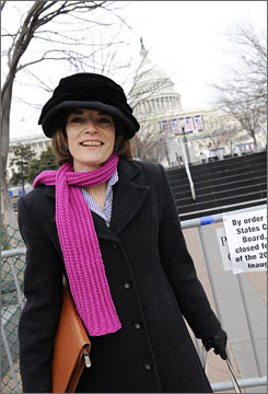 Political reporter Kathy Kiely shows off the fuschia scarf she knitted while reporting from the Obama campaign trail. There's a good chance she'll be wearing it on Tuesday when Obama takes the oath of office at the West Front of the U.S. Capitol  directly behind where Kiely is standing .