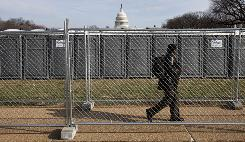 Portable toilets and security fences line the National Mall by the Capitol.