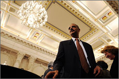 Members of the Senate Judiciary Committee questioned witnesses Friday about Eric Holder, President-elect Barack Obama's pick to head the Justice Department. Here, Holder is seen n the hearing room on Thursday.