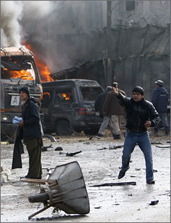 An Afghan man yells for help after a blast at the German embassy in Kabul on Saturday.