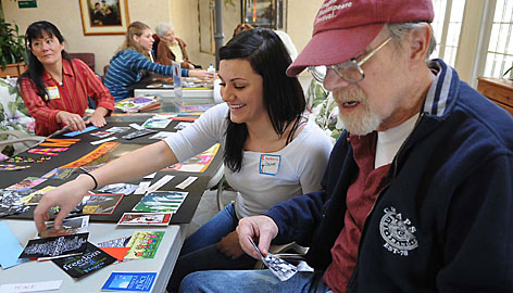 Lauren Akbar, a senior at North Valleys High, works with Chuck Sabine as the two put together a collage of images honoring Martin Luther King Jr. on Monday. Akbar was one of about 40 young people visting residents at The Arbors in Sparks as part of a national day of service in observance of Martin Luther King Jr. Day.