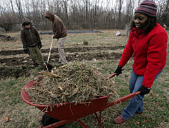 Marisa Woodley clears land for spring planting at the West Nashville Community Farm on Monday. This community-supported agriculture enterprise provides vegetables to low-income people at a discount if they commit to volunteer.