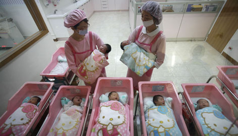 Nurses in the Hello Kitty-designed maternity ward, at the Hau Sheng hospital, hold newborns, Tuesday in the southern Taiwan city of Chunghua.