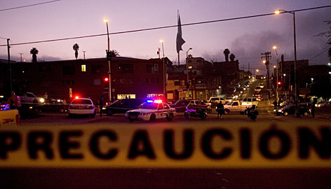Police tape surrounds a Tijuana crime scene after a shooting Dec. 1. Tijuana saw its bloodiest year ever in 2008 with 843 killings compared to 337 the previous year.