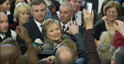 Secretary of State Hillary Rodham Clinton is greeted by department employees Thursday in Washington. About 1,000 cheering employees welcomed Clinton on her first day.