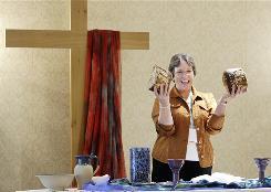 Bishop Deborah Kiesey celebrates communion during a service at a United Methodist Church gathering of female pastors in Nashville, Tenn., Sept. 16.