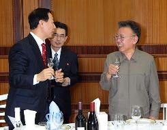 North Korean leader Kim Jong-il (R) and Wang Jiarui (L), head of the International Department of the Central Committee of the Communist Party of China, toast at a meeting in Pyongyang, North Korea, on Jan. 23  in this photo released by North Korea's official news agency, KCNA. Kim met Wang, a senior Chinese official, in Kim's first reported meeting with a foreign envoy since a suspected stroke in August.
