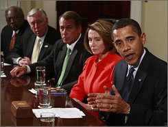 President Obama, seated next to Congressional leaders, speaks to the press before a meeting with bipartisan congressional leadership in the Cabinet Room of the White House Friday.