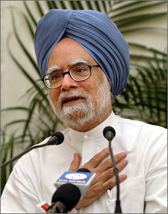 Doctors in India say heart bypass surgery on Prime Minister Manmohan Singh, seen here during a press conference in Nagpur, India, in July 2006, was a success.