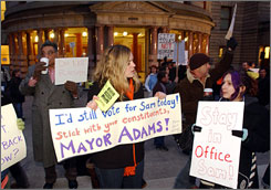 Mayor Sam Adams of Portland, Ore., under fire for a relationship with a legislative intern, is deciding whether to resign. Here, some supporters of the mayor take part in a rally in Portland on Friday.