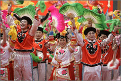 People in China are preparing to celebrate the arrival of the Year of the Ox. Here, folk dancers perform at an opening ceremony of a fair in Beijing on Sunday.