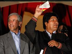 Bolivia's Vice President Alvaro Garcia Linera, left, and President Evo Morales attend a political rally Sunday in La Paz. Morales won a referendum that changes term limits, allowing him to stay in power longer.