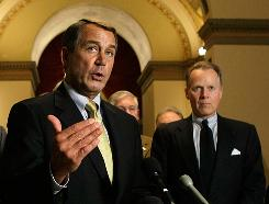 House Minority Leader John Boehner gestures as he and other House Republicans discuss the economic stimulus plan voted on Wednesday.