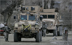 U.S. military vehicles pass through Ningarhar Province near Kabul, Afghanistan, on Jan. 17. NATO has announced that thousands of U.S. troops who were destined for Iraq have deployed south of Kabul.