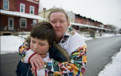 Brandy Hickman, 29, and her 9-year-old son, Paul Cortez, were living with her mother, Jane Hickman, until a fire destroyed Jane's row house Saturday in Coatesville, Pa. Now Brandy and Paul are staying with an aunt.