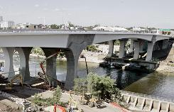 Construction of the new Interstate 35W bridge over the Mississippi River nears completion in September 2008. The Aug. 1, 2007, collapse of the 1,000-foot-long structure claimed 13 lives, injured 145 people and crippled Minneapolis' transportation system.