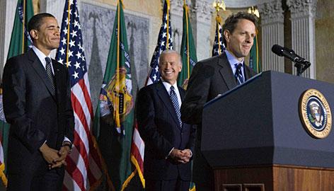 President Barack Obama, left, and Vice President Joe Biden, listen to Treasury Secretary Timothy Geithner speak after Biden swore him in as Treasury Secretary at the Treasury Department on Monday in Washington.