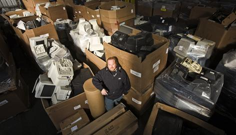 Universal Waste Management president and CEO Jacob Cherry stands amid discarded monitors at his processing plant in Oakland. With the switch to digital, many people are ditching their old TV sets, and what's inside can be toxic to the environment.