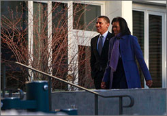 President Obama and First Lady Michelle Obama arrive on Thursday at the Bethesda, Md., campus of Sidwell Friends School, where their younger daughter, Sasha, attends classes.
