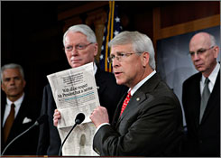 Sen. Roger Wicker, R-Miss., joined other Senate Republicans Thursday in opposing President Obama's financial stimulus package. Here, Wicker displays a newspaper advocacy ad.