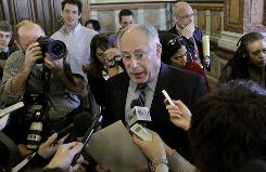 New Illinois Gov. Pat Quinn speaks to reporters at the state capitol in Springfield, Ill., on Friday. Quinn was sworn in as governor after the Illinois Senate vote 59-0 to remove the impeached Gov. Rod Blagojevich.