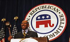 Michael Steele holds up a gavel after he is elected the first black Republican National Committee chairman Friday in Washington, D.C.