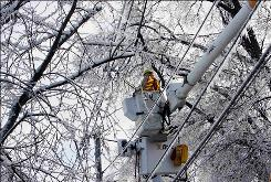 A lineman works to restore electricity to Louisville residents, days after an ice storm hit the city.