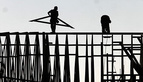 A building goes up in Folsom, Calif., in January. Mark Zandi, chief economist at Moody's Economy.com, estimates the stimulus package could give the construction industry a 6.6% boost in jobs.