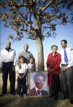 Tim Cole was wrongfully convicted of a 1985 rape and died in prison in 1999. His family is seeking to clear his name. Tim Cole's family, from left, are: brothers Kevin Kennard and Sean Session, nephew Gavin Session, niece Ruby Maria Session, mother Ruby Cole Session and brother Cory Session.