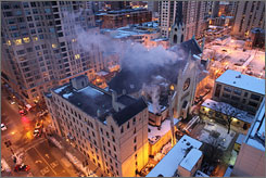 Firefighters battled flames Wednesday morning at Chicago's landmark Holy Name Cathedral.