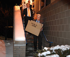 FBI agents carry boxes out of James W. Lewis' apartment in Cambridge, Mass., after searching the home. Lewis was linked to the fatal 1982 Tylenol poisonings that triggered a nationwide scare and prompted dramatic changes in the way food and medical products are packaged. The FBI would not immediately confirm that the search was related to the Tylenol case, only that it was part of an ongoing investigation.