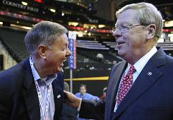 Sen. Lindsey Graham, left, and Sen. Johnny Isakson chat at the GOP convention in St. Paul in September. Isakson sought a tax credit provision for home buyers in the Senate version of the stimulus package.