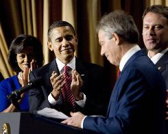 Former British prime minister Tony Blair, second from right, pictured with the Obamas, speaks at the National Prayer Breakfast in Washington.