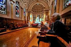 """Sister Camille D'Arienzo, 76, a past president of the Brooklyn Sisters of Mercy order visits the chapel at the Convent of the Sisters of Mercy in Brooklyn, N.Y. """"The chapel means more to me than any spot on earth and I cannot bear the thought of losing it,"""" she said."""