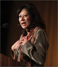 Sam Sayyad, the husband of Rep. Hilda Solis, President Obama's nominee to head the Labor Department, has settled outstanding tax liens against his business, the administration reported. Here, Solis is seen speaking at a luncheon in Washington on Jan. 18.