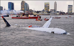 "US Airways Flight 1549 floats in the Hudson River on Jan. 15. Capt. Chesley ""Sully"" Sullenberger has told FAA investigators he glided the plane into the river rather than risking a catastrophic crash in a densely populated area. All 155 aboard survived."