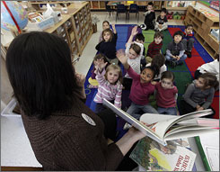 Students in Connie Levin's kindergarten class answer questions  Wednesday at Daniel Warren Elementary School in Mamaronek, N.Y. Throughout the year Levin incorporats famous figures from different cultural backgrounds, including African-American history, to teach her students about mutual respect and community.